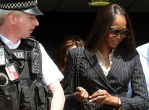 Naomi Campbell escorted by police